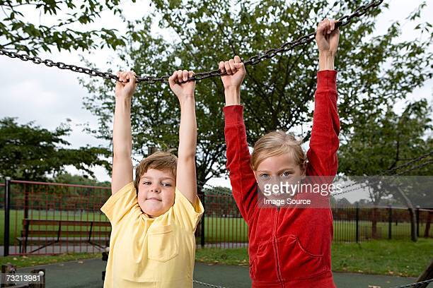 Boy and girl holding a chain