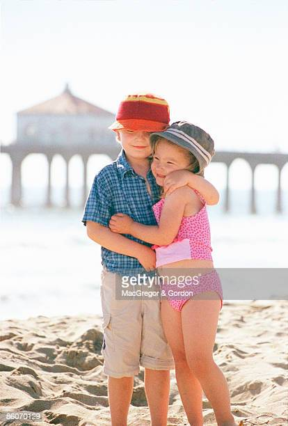 Boy and girl hugging on beach