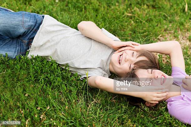 Boy and girl hugging on the grass