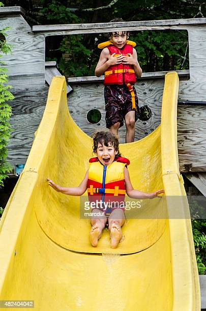 Boy and girl  in a water slide