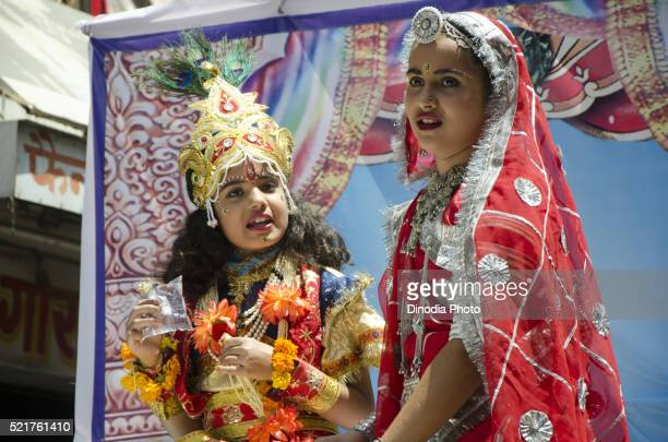 boy and girl in fancy dress radha krishna in ramnavami procession, jodhpur, rajasthan, india - radha krishna stock pictures, royalty-free photos & images