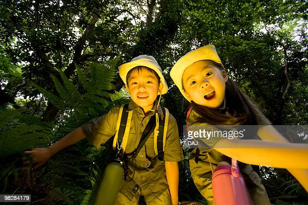 Boy and girl in forest