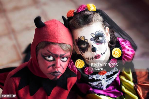 boy and girl in halloween fancy dress costumes - human skeleton stock pictures, royalty-free photos & images