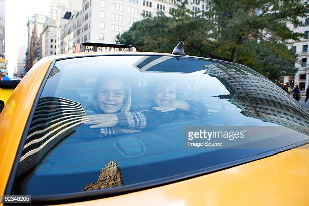 Boy and girl in taxicab