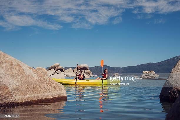 Boy and girl kayaking, Lake Tahoe, California, America, USA
