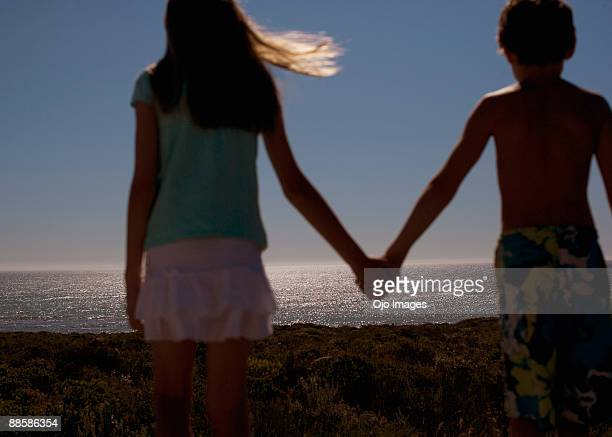 Boy and girl looking at ocean view