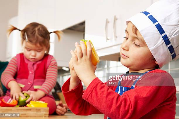 boy and girl looking at vegetables - nursery school child stock pictures, royalty-free photos & images