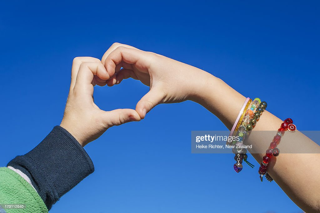 Boy And Girl Love Heart Stock Photo | Getty Images