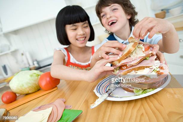 A boy and girl making a sandwich