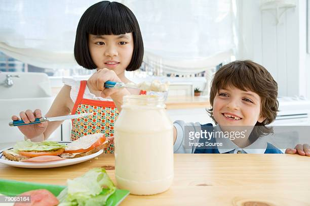 Boy and girl making a sandwich