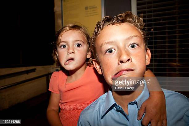Boy and Girl Making Funny Faces