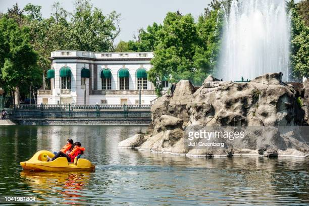 A boy and girl on a pedal boat on the lake at Bosque de Chapultepec forest park