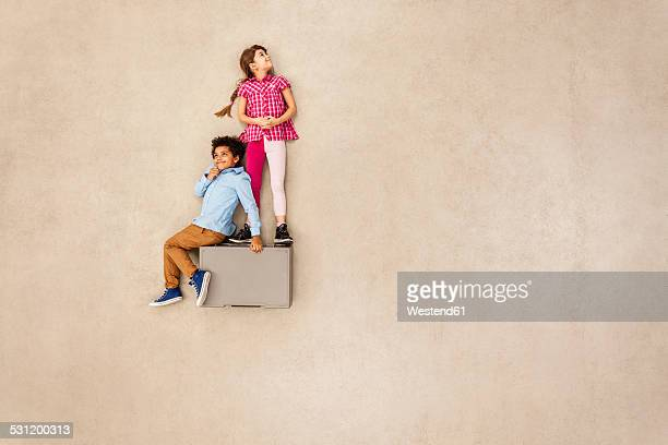 Boy and girl on box