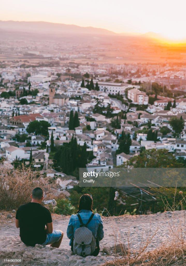 Boy and girl on mountain : Stock Photo