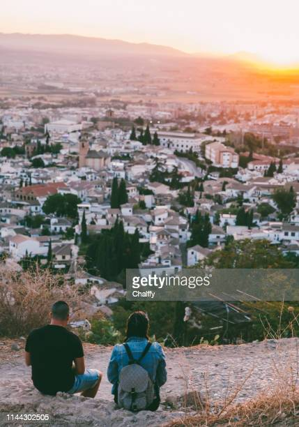 boy and girl on mountain - granada spain stock pictures, royalty-free photos & images