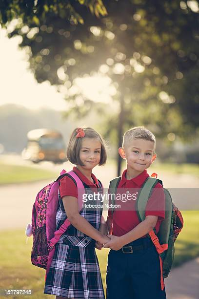 Boy and girl on their first day of Kindergarten