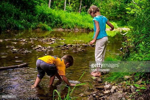 A boy and girl play in the Four Mile Creek in Oxford Oh