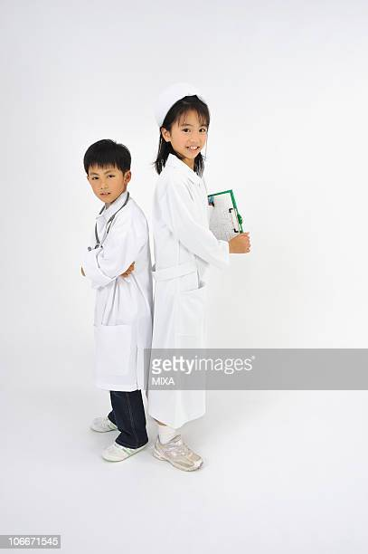 Boy and girl playing as doctor and nurse