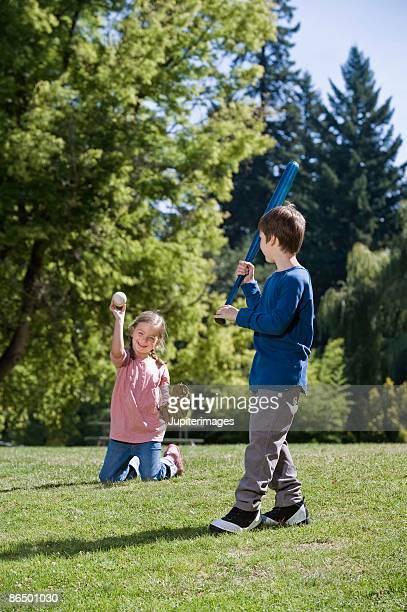 Boy and girl playing baseball