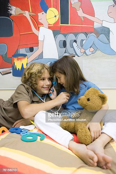 Boy and girl playing doctor