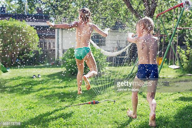 Boy and girl playing in garden