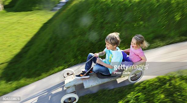 boy and girl playing in go kart