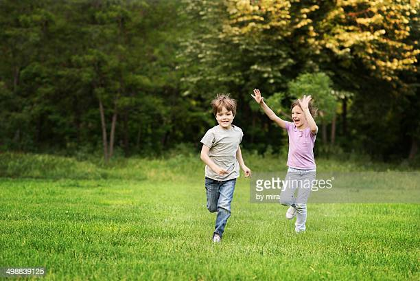 boy and girl playing in park