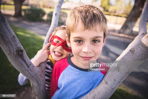 Boy and Girl playing in Tree