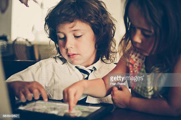 Boy and girl playing on a tablet