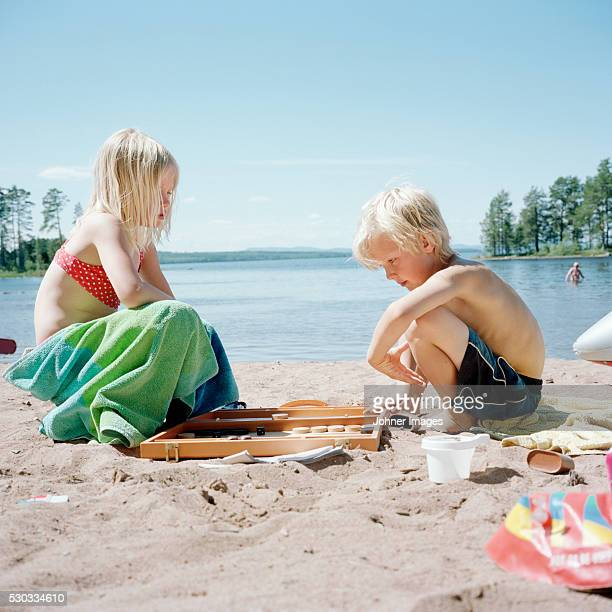 Boy and girl playing on beach