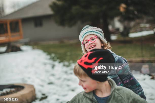 boy and girl playing outside - sioux falls stock pictures, royalty-free photos & images
