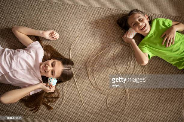 boy and girl playing social distance communication - miljko stock pictures, royalty-free photos & images