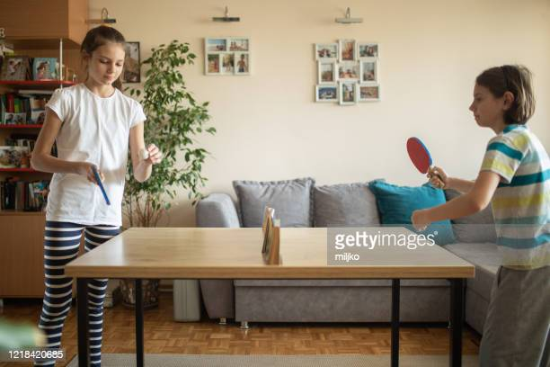 boy and girl playing table tennis at home - table tennis stock pictures, royalty-free photos & images