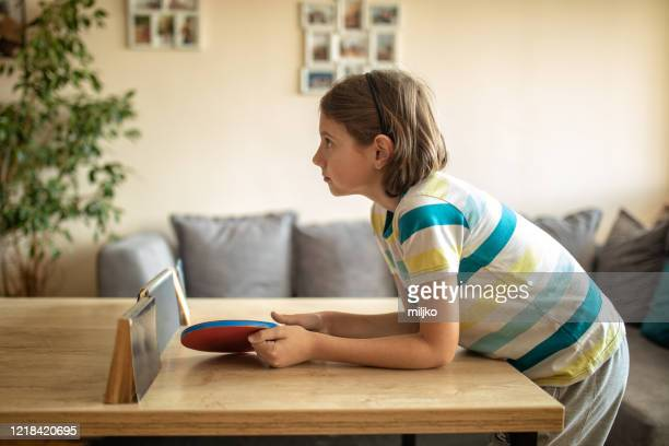 boy and girl playing table tennis at home - makeshift stock pictures, royalty-free photos & images