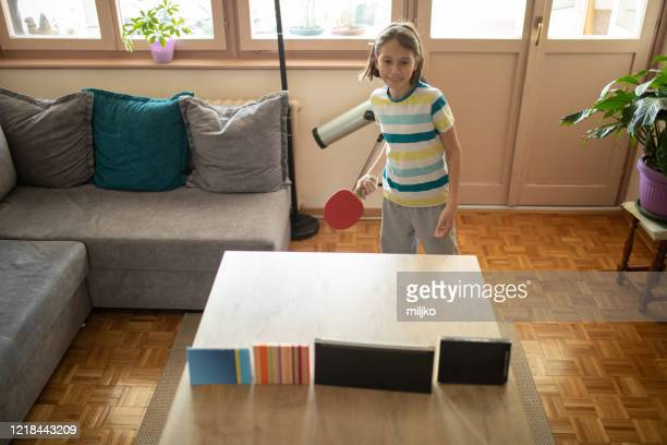 boy and girl playing table tennis at home - miljko stock pictures, royalty-free photos & images