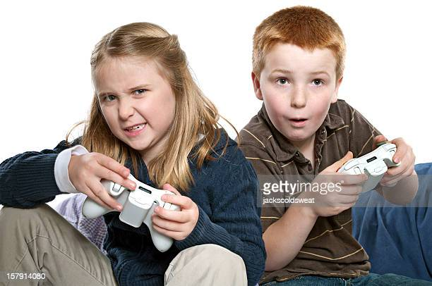 Boy and girl playing video games competitively