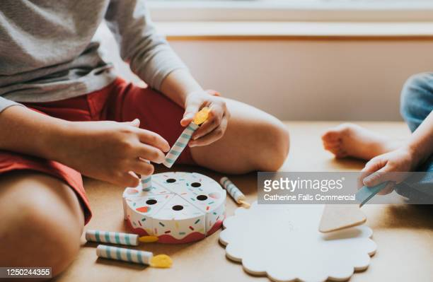 boy and girl playing with a wooden birthday cake - rpg maker stock pictures, royalty-free photos & images