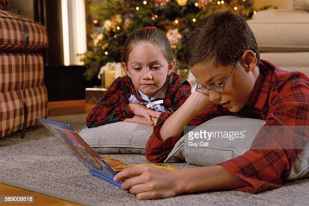 boy and girl reading pop up book - pop up book stock pictures, royalty-free photos & images