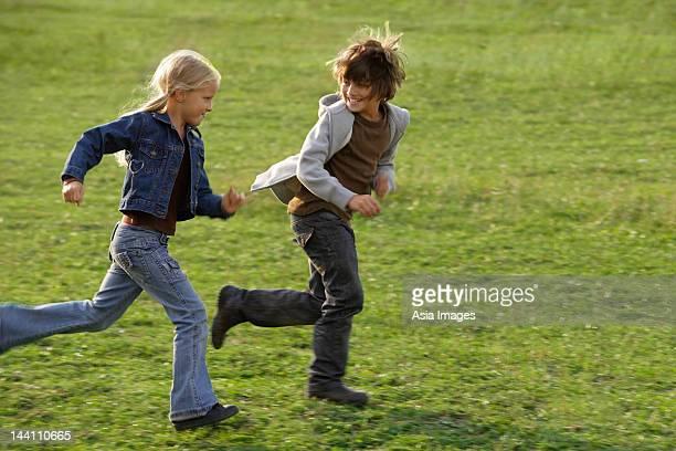 boy and girl running