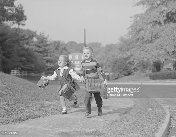 boy and girl running with book - {{relatedsearchurl(carousel.phrase)}} stock pictures, royalty-free photos & images