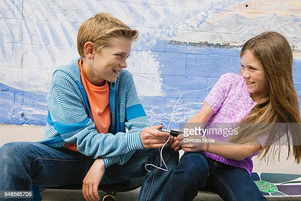 Boy and girl sharing mp3 player