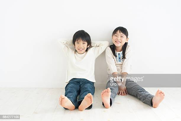 Boy and girl sitting on floor