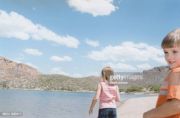 Boy and Girl Skipping Stones