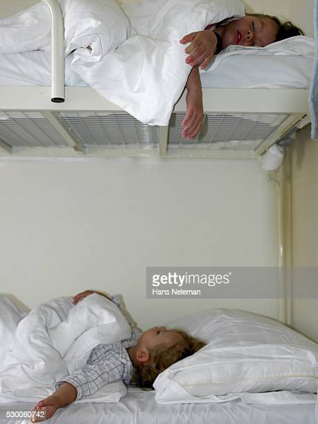 Boy and Girl Sleeping in Bunk Bed