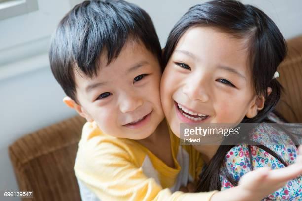 Boy and girl smiling cheek to cheek