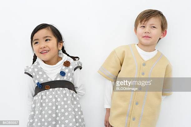 Boy and girl standing side by side