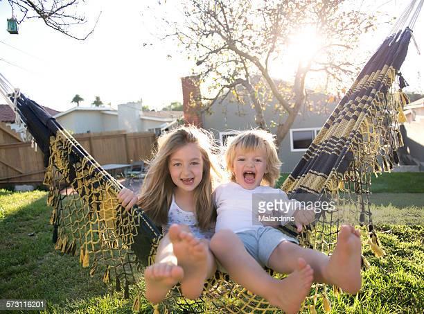 Boy and Girl Swinging on a Hammock