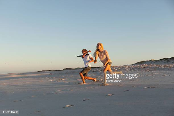 Boy and Girl throwing stones