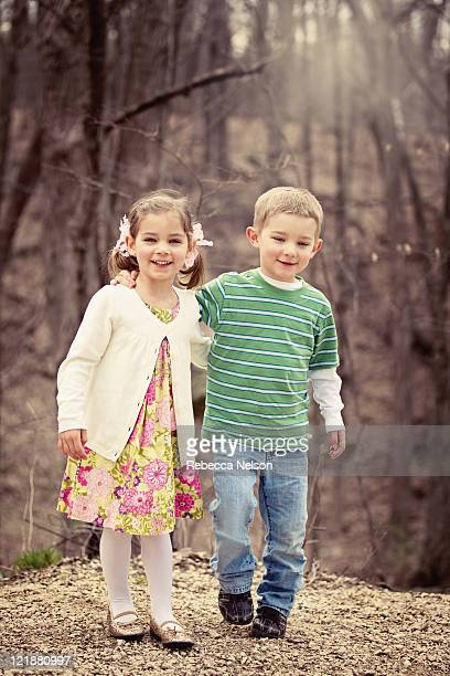 Boy and girl twins in forest preserve