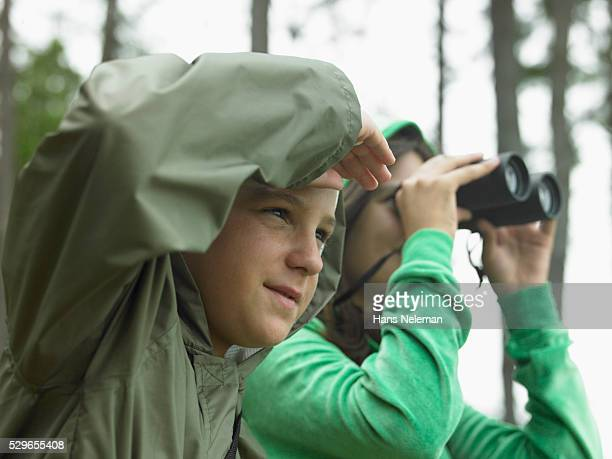 Boy and Girl Using Binoculars